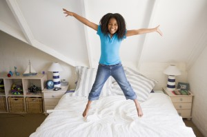 girl-jumpng-on-bed-1024x682