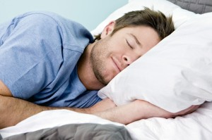 man-sleeping-in-bed-1024x682